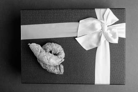 Studio Shot Of Gift Box Against Gray Background Stock Photo