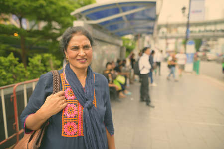 Mature beautiful Indian woman exploring the city of Bangkok, Thailand