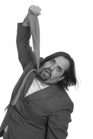 Fat Caucasian businessman pulling his own tie Archivio Fotografico