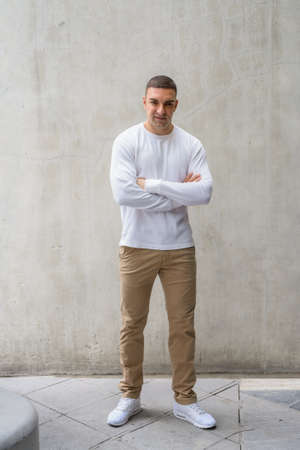 Full body shot of handsome man with arms crossed Reklamní fotografie