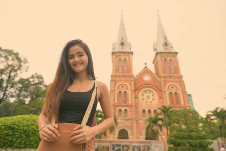 Young beautiful Asian tourist woman exploring Ho Chi Minh city in Vietnam