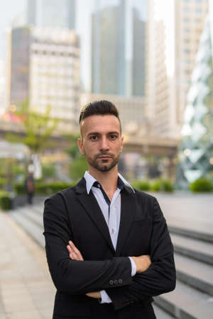 Portrait of handsome young businessman outdoors in city 免版税图像
