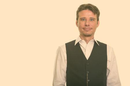 Handsome formal Caucasian man wearing vest