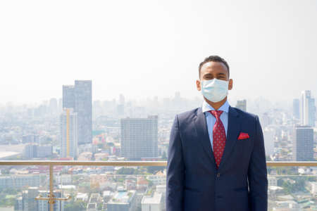 African businessman with surgical medical mask for protection Banco de Imagens