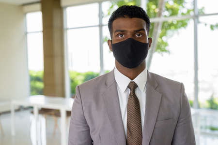 Portrait of African businessman with surgical medical mask for protection