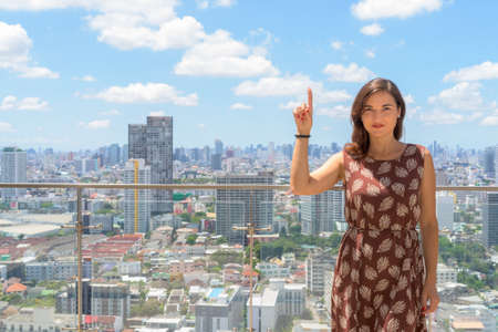 Portrait of beautiful woman outdoors at rooftop with city view