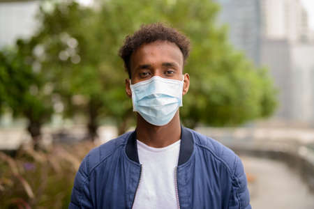 African man wearing face mask to protect against virus