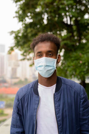 Portrait of handsome black African man wearing face mask