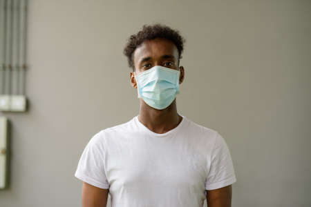 African man wearing face mask and looking at camera