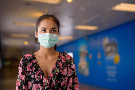 Portrait of woman wearing face mask for protection against virus