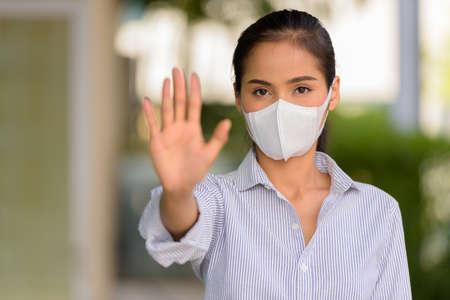 Asian woman wearing face mask to protect from coronavirus Covid-19 horizontal shot