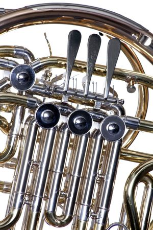 french horn: A gold brass French horn close up isolated against a white background  in the horizontal format. Stock Photo