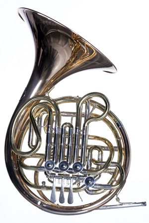A gold brass French horn isolated against a white background  in the horizontal format.