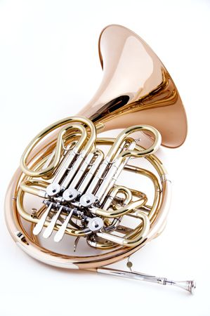 french horn: A French horn isolated close-up against a high key white background in the vertical view with copy space.