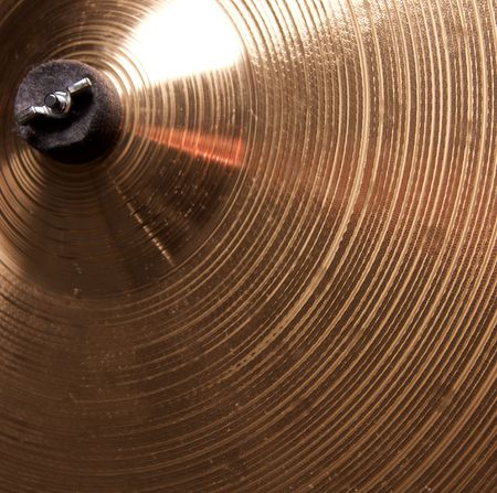 A bronze brass cymbal close up in the square format. Stock Photo