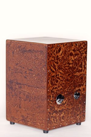 A Carubinga wood box cajon percussion instrument isolated against a white background in the vertical format.