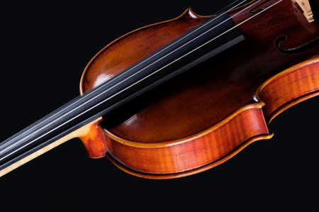 vibrations: A complete violin viola isolated against a black background in the horizontal format with copy space. Stock Photo