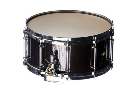 horizontal format horizontal: A wine colored snare drum isolated against a white background in the horizontal format. Stock Photo