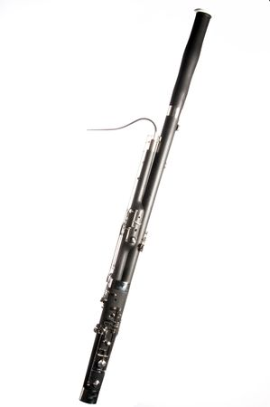 A complete woodwind bassoon music instrument isolated against a white background.