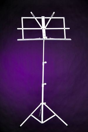 vertical format: A white music stand isolated against a purple background in the vertical format.
