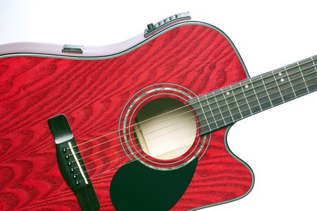 horizontal format horizontal: A red acoustic electric guitar  isolated against a white background in the horizontal format.