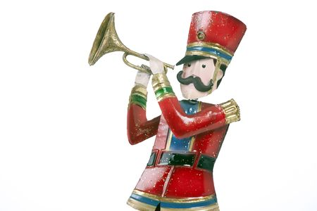 horizontal format horizontal: A toy soldier trumpet player isolated against a white background in the horizontal format.