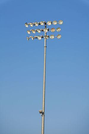 Stadium light isolated against a blue sky background Stock Photo - 8193672