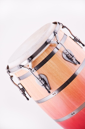An African conga drum isolated against a white background in the vertical format. photo