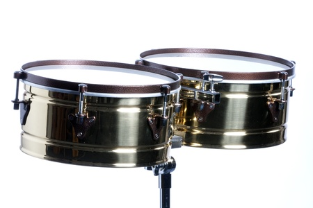 A gold brass timbales isolated against a white background in the horizontal format with copy space.