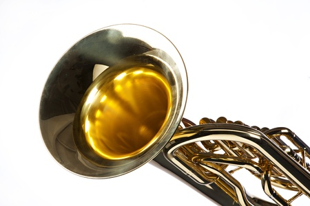 horizontal format horizontal: A gold colored brass tuba euphonium isolated on a white background in the horizontal format.