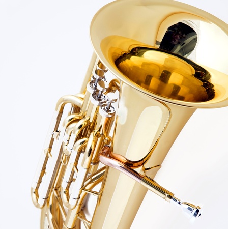 A gold brass tuba euphonium isolated against a white background in the square format.