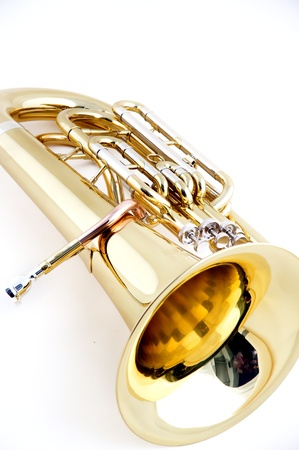 tuba: A gold brass bass tuba isolated on a white  background in the vertical format.