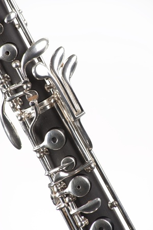 An oboe woodwind instrument isolated against a white background in the vertical format. Stock Photo