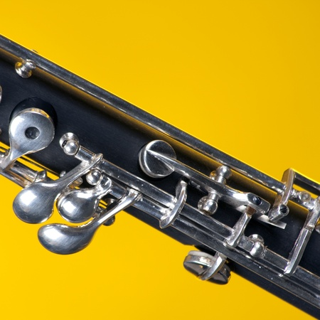 double reed: An oboe up close isolated against a yellow background in the square format with copy space. Stock Photo