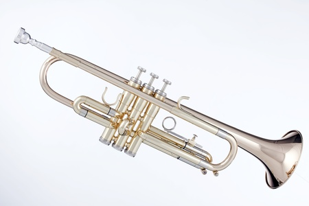A professional gold brass trumpet isolated against a white background in horizontal format. Stok Fotoğraf