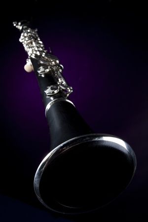 beethoven: A soprano clarinet isolated against a black background in the vertical format. Stock Photo