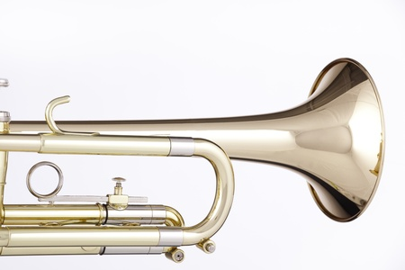 A gold and brass trumpet or cornet isolated against a white background.