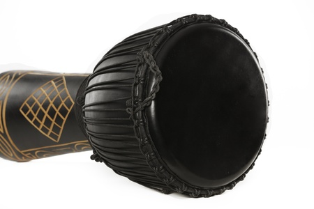 A black djembe conga drum isolated against a white background. photo