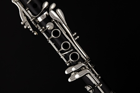 A soprano clarinet isolated against a black background