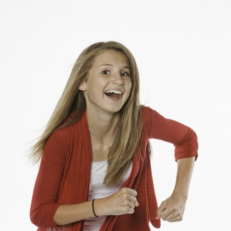 A happy active pretty teenage female girl isolated against a white background.