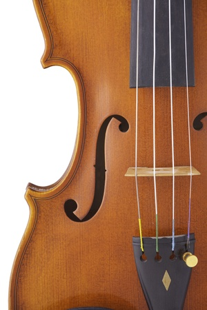 An antique violin viola isolated against a whit background.