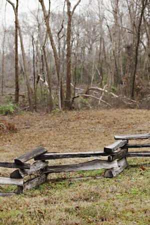 split rail: A rustic split rail fence on overcast day.