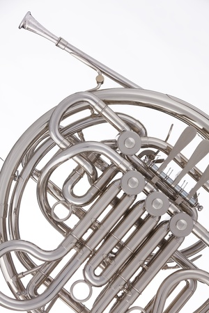 brass band: A professional silver French  horn isolated against a white background. Stock Photo