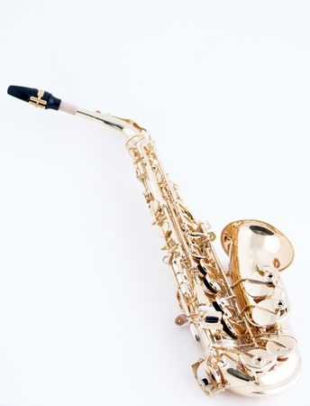 brass band: An alto saxophone isolated against a high key white background in the vertical view with copy space.