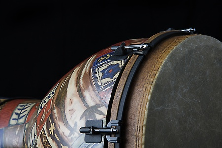 African djembe conga drum isolated closeup on its side against a black background in the horizontal format with copy space. photo