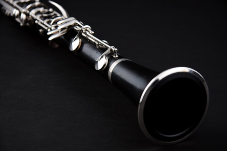 horizontal format horizontal: A soprano clarinet isolated against a black background in the  horizontal format with copy space. Stock Photo