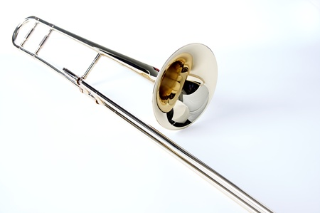 A silver  trombone isolated against a white background in the horizontal format with copy space.
