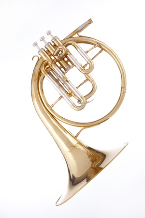french horn: A gold brass antique French horn or peckhorn isolated against a white background. Stock Photo