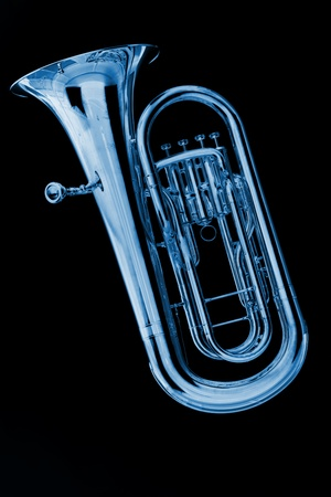 band instruments: A blue color tuba or euphonium isolated against a black background in the vertical format.