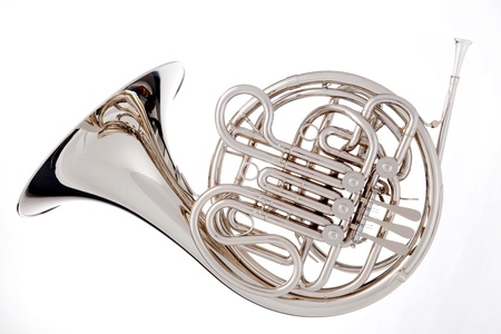 french horn: A silver French horn isolated against a white background in the horizontal format. Stock Photo